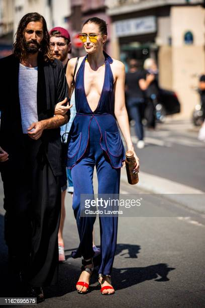 Model Anna Cleveland , wearing a blue top with matching pants, yellow sunglasses and silver and red heels, is seen outside Jean Paul Gaultier show...