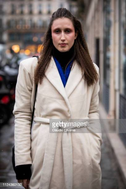 Model Anna Cleveland wearing a cream coat is seen outside Jean Paul Gaultier show during Paris Fashion Week Haute Couture Spring Summer 2019 on...