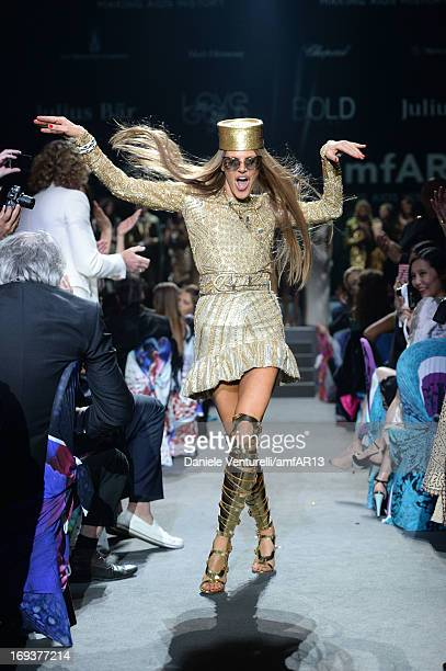 Model Anna Dello Russo walks the runway as part of amfAR's 20th Annual Cinema Against AIDS during The 66th Annual Cannes Film Festival at Hotel du...
