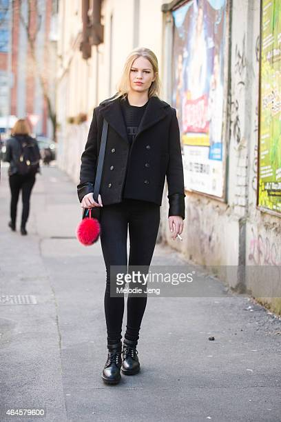 Model Anna Ewers exits the Fendi show in an Alexander Wang top and a Fendi accessory on February 26 2015 in Milan Italy