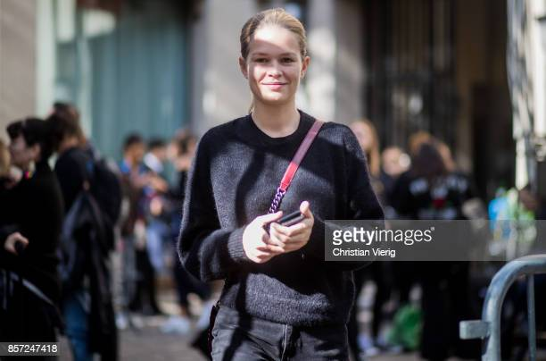Model Anna Ewers seen outside Miu Miu during Paris Fashion Week Spring/Summer 2018 on October 3 2017 in Paris France