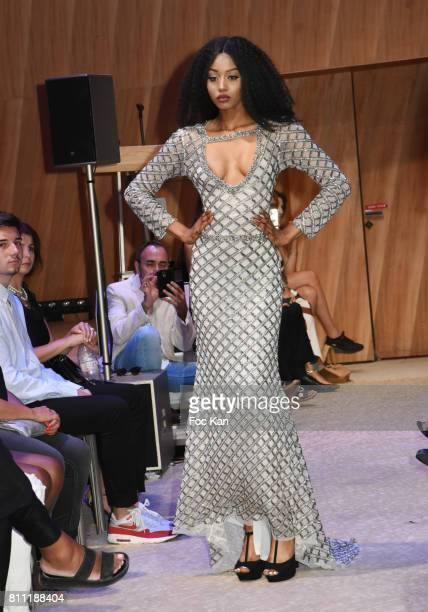 """Model Anna Faye dressed by Sublim Elle walks the runway during the """"Paris Appreciation Awards 2017"""" At The Eiffel Tower on July 8, 2017 in Paris,..."""