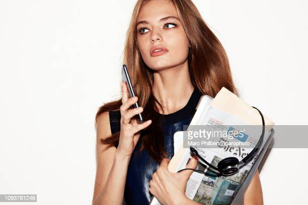 Model Anna Mila poses at a beauty shoot for Madame Figaro on October 12 2018 in Paris France Dress rings MacBook and iPad headphones PUBLISHED IMAGE...