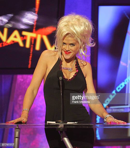 Model Anna Nicole Smith announces the performance by Kanye West during the 32nd Annual American Music Awards at the Shrine Auditorium November 14...