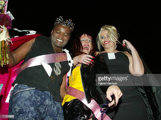 July 21: Model Anna Nicole Smith dances with contestants King Enron VIII and Sylvia Krappstein during the 2nd Annual Queen of Silverlake Pageant on...