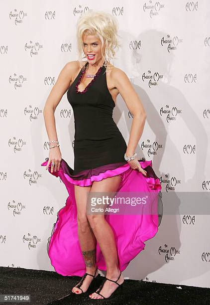 Model Anna Nicole Smith poses in the press room at the 32nd Annual 'American Music Awards' at the Shrine Auditorium November 14 2004 in Los Angeles...