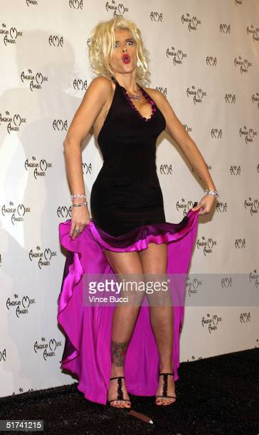 Model Anna Nicole Smith poses in the pressroom at the 32nd Annual 'American Music Awards' at the Shrine Auditorium on November 14 2004 in Los Angeles...