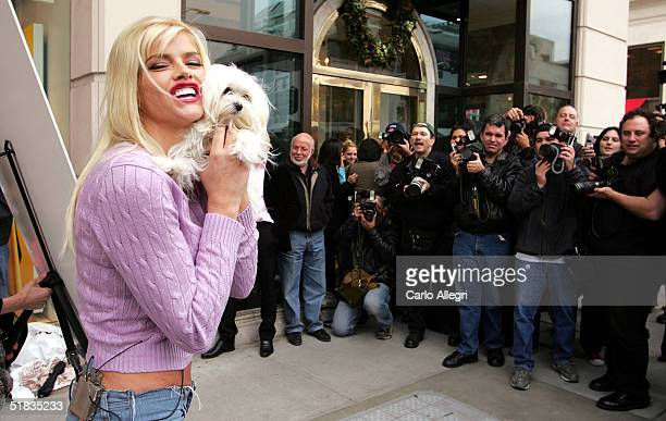 """Model Anna Nicole Smith poses on Rodeo Drive as she unveils a poster to promote a new """"Gentlemen Prefer Fur-Free Blondes"""" ad for People For The..."""