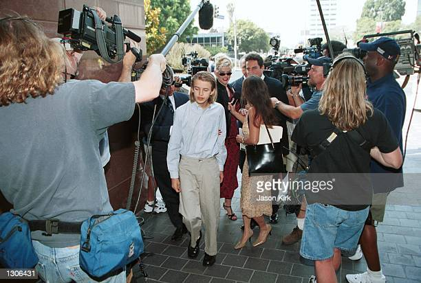 Model Anna Nicole Smith with her son Daniel and her attorney Philip Boesch walk through the crowd outside the Los Angeles courthouse July 25 2000 in...