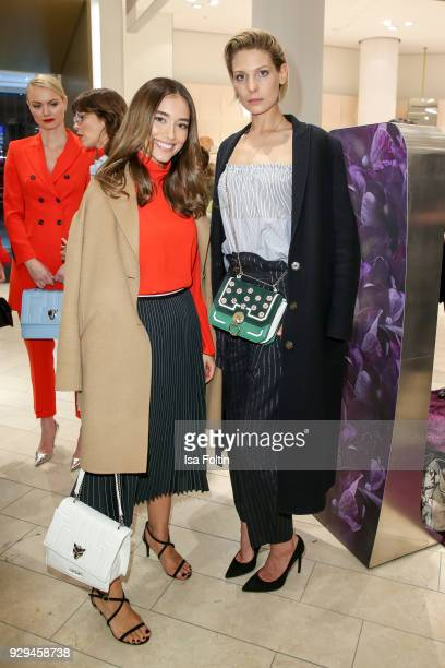 Model Anna Sharypova and German actress Sarah Brandner during the 'Marc Cain loves Breuninger' event on March 8 2018 in Duesseldorf Germany