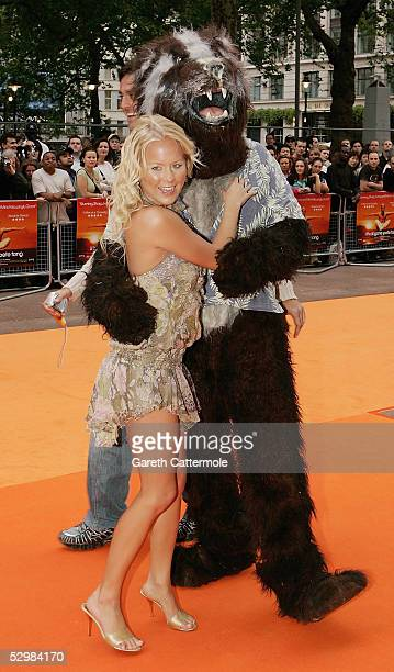 Model Anna Taverner and the Coke Badger arrive at the UK premiere of 'It's All Gone Pete Tong' at Empire Leicester Square on May 26 2005 in London