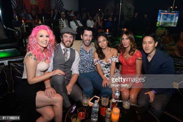 Model Annalee Belle television personalities JD Scott and Drew Scott and Linda Phan attend the Coach Woodson Las Vegas Invitational red carpet and...