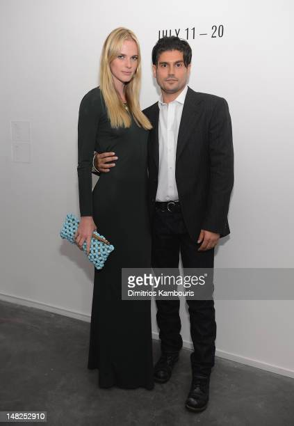 Model Anne Vyalitsyna and artist Andrew Levitas attend 'Metal Works Photography Sculptures' By Andrew Levitas Exhibition at Phillips de Pury Company...