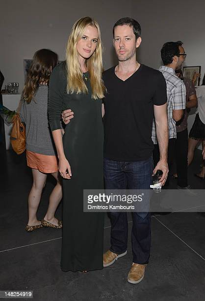 Model Anne Vyalitsyna and Darren Le Gallo attend Metal Works Photography Sculptures By Andrew Levitas Exhibition at Phillips de Pury Company on July...