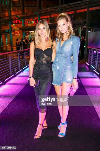 Model AnnKathrin Broemmel and model Mandy Bork attend the 'Atomic Blonde' World Premiere at Stage Theater on July 17 2017 in Berlin Germany