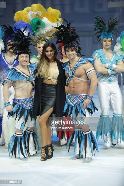 Model AnnKathrin Broemmel poses with dancers of the 'Holiday on Ice' birthday show in Berlin Germany 01 March 2015 The show tours ten German cities...