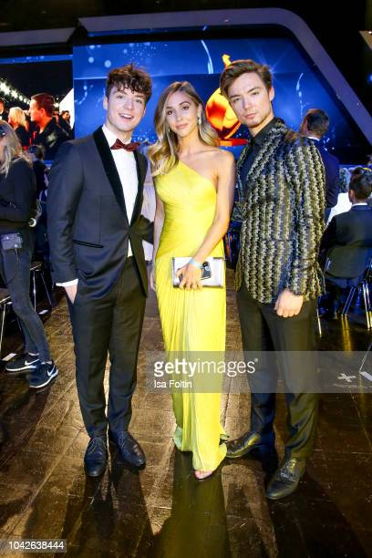 Model Ann-Kathrin Goetze with youtube stars Roman and Heiko Lochmann alias Die Lochis during the Goldene Henne on September 28, 2018 in Leipzig,...
