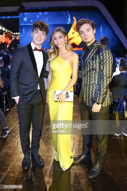 Model AnnKathrin Goetze with youtube stars Roman and Heiko Lochmann alias Die Lochis during the Goldene Henne on September 28 2018 in Leipzig Germany