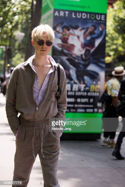 Model Anton Jensen wears a matching grey jumpsuit jacket and pants during Paris Fashion Week Men's Spring/Summer 2018 on June 22 2017 in Paris France