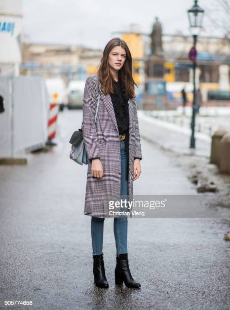 Model Antonia Wesseloh wearing Topshop skinny denim jeans Mango boots New Look coat Chloe bag is seen during the Berlin Fashion Week January 2018 at...