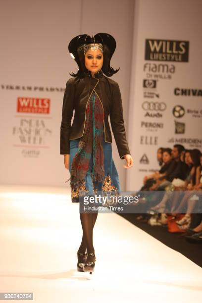 Model Anushka Sharma walks the ramp for fashion designer Vikram Phadnis show at Wills Lifestyle India Fashion week in New Delhi