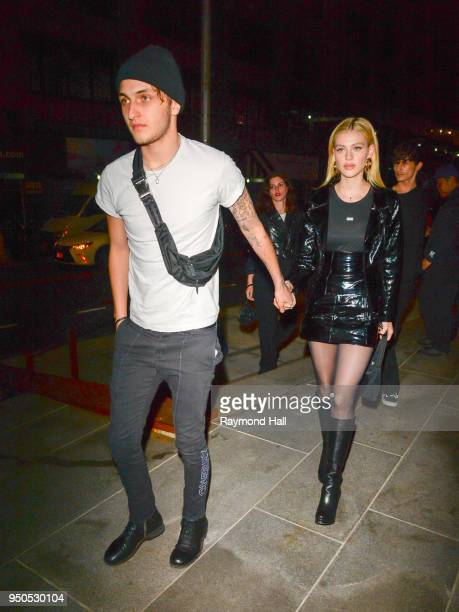 Model Anwar Hadid and Nicola Peltz are seen arriving at Gigi Hadid's party in Brooklyn on April 23 2018 in New York City