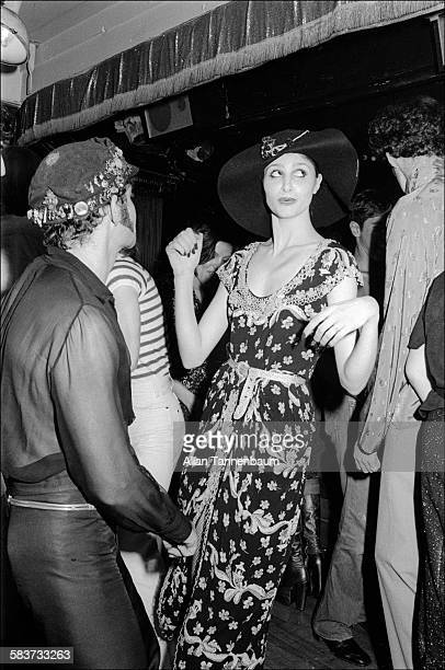 Model Apollonia von Ravenstein dances with stylist Ara Gallant at the 82 Club New York New York May 10 1974