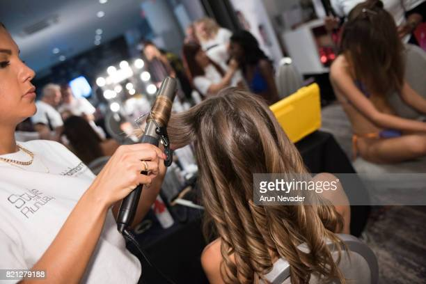 Model appears backstage for Art Hearts Fashion Miami Swim Week at SLS Hyde Beach on July 22 2017 in Miami Florida