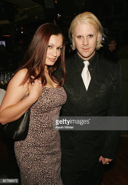 Model Aria Giovanni and musician John Five pose at 'Rock the Cure' an auction of 50 custonmade Gibson guitars designed by celebrities and rock stars...