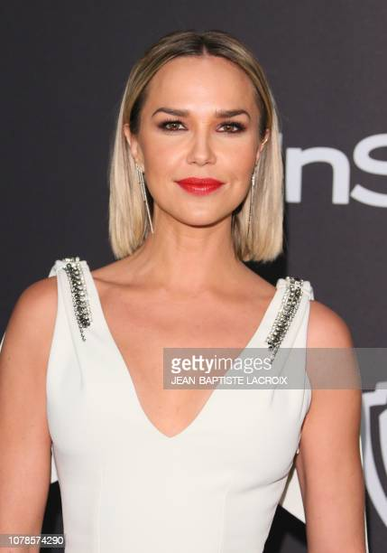 US model Arielle Kebbel arrives for the Warner Bros and In Style 20th annual post Golden Globes party at the Oasis Courtyard of the Beverly Hilton...