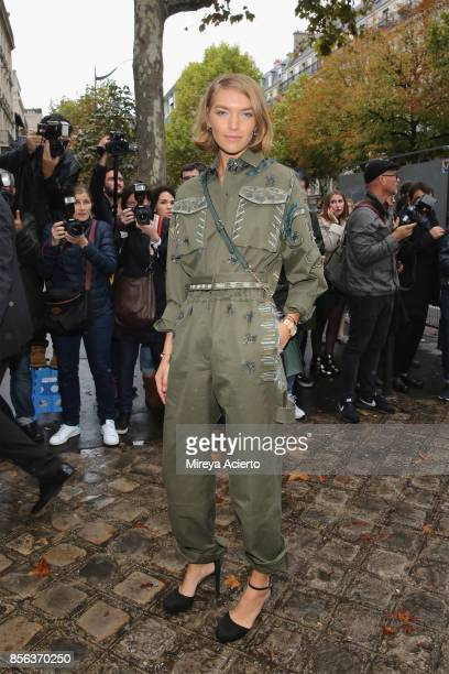 Model Arizona Muse attends the Valentino show as part of the Paris Fashion Week Womenswear Spring/Summer 2018 on October 1 2017 in Paris France
