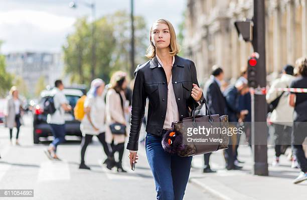 Model Arizona Muse wearing a Louis Vuitton bag and leather jacket outside Lanvin on September 28 2016 in Paris France
