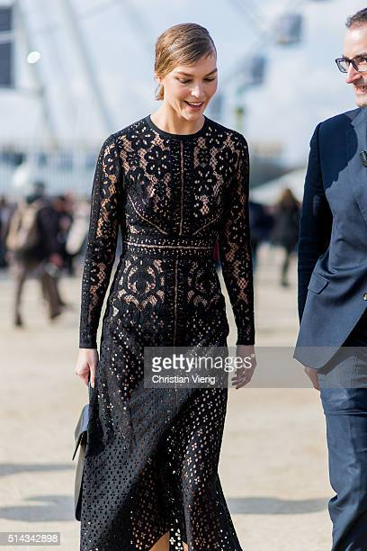 Model Arizona Muse wearing a sheer black dress from Elie Saab outside Elie Saab during the Paris Fashion Week Womenswear Fall/Winter 2016/2017 on...