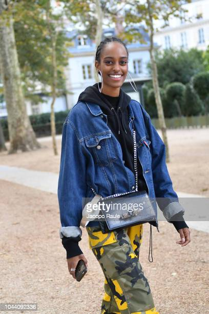 A model arrives at Alexander McQueen show as part of the Paris Fashion Week Womenswear Spring/Summer 2019 on October 1 2018 in Paris France