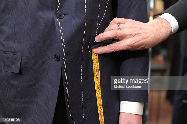 Model Arthur Keller is fitted in a suit by Ermenegildo Zegna tailor Jasmin Vejsilovic during the 500 Hands event with Jason Taylor And Bart Scott...