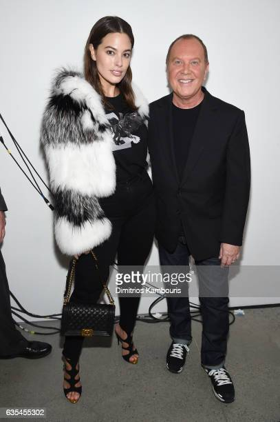 Model Ashley Graham and designer Michael Kors pose backstage before the Michael Kors Collection Fall 2017 runway show at Spring Studios on February...