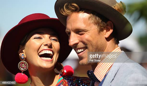 Model Ashley Hart with husband Buck Palmer at The 2015 Melbourne Cup Day at Flemington Racecourse on November 3 2015 in Melbourne Australia
