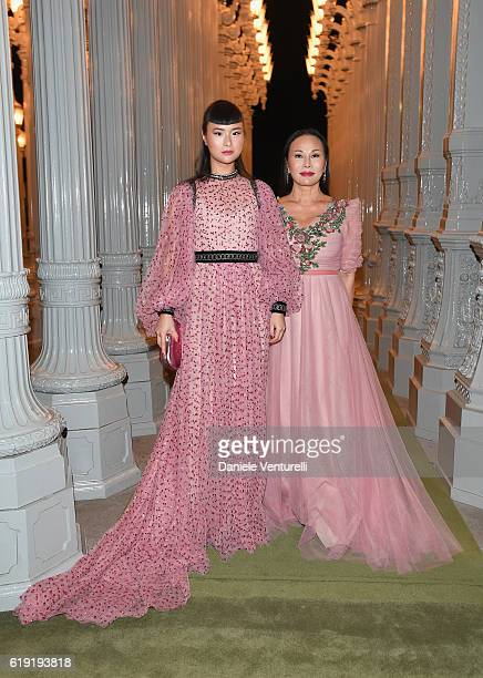 Model Asia Chow and host Eva Chow both wearing Gucci attend the 2016 LACMA Art Film Gala Honoring Robert Irwin and Kathryn Bigelow Presented By Gucci...