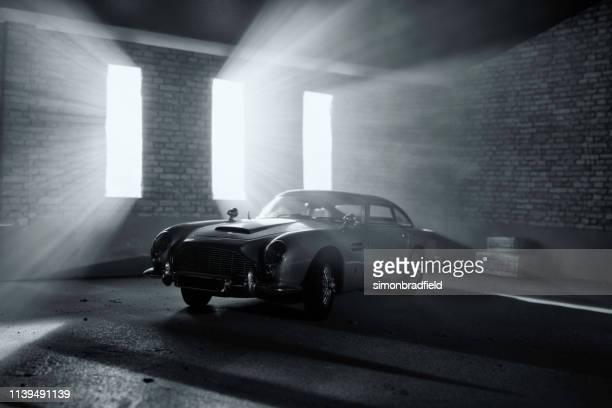model aston martin db5 in atmospheric garage - aston martin stock pictures, royalty-free photos & images