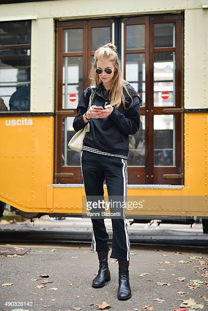 Model Astrid Ericsson poses wearing Dondup pants and Gucci shoes and bag before the Dolce and Gabbana show during the Milan Fashion Week...