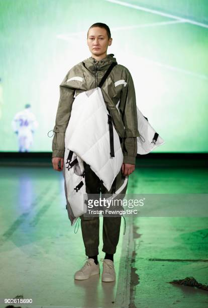 A model at the JORDANLUCA DiscoveryLab presentation during London Fashion Week Men's January 2018 at BFC Show Space on January 8 2018 in London...