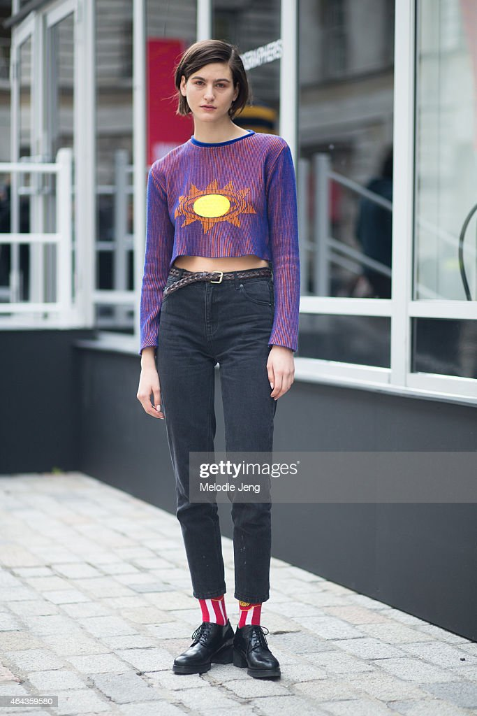 Model Athena Wilson exits the Christopher Raeburn show in a Daniel Pool rave top and Levi's jeans during London Fashion Week Fall/Winter 2015/16 at Somserset House on February 24, 2015 in London, England.