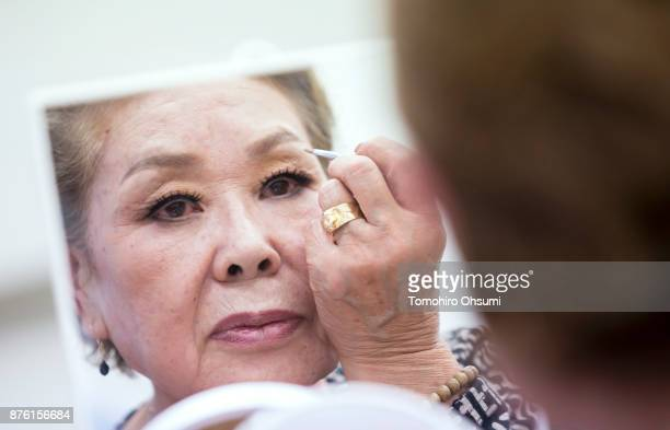 A model attends a class teaching how to apply makeup held ahead of the Gamo Colle or Sugamo Collection 2017 show on November 18 2017 in Tokyo Japan...