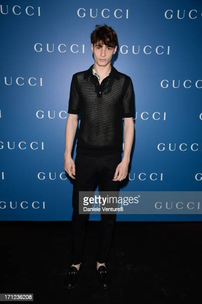 A model attends Gucci Men's Flagship Store Opening and Launch of Gucci Made to Measure Capsule Collection 'Lapo's Wardrobe' on June 23 2013 in Milan...