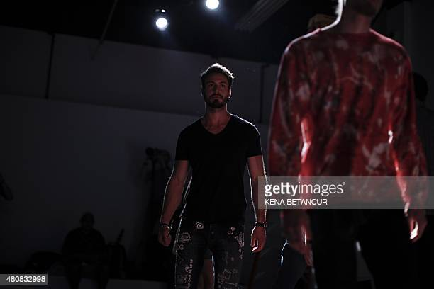 A model attends the rehearsal before the Grungy Gentleman show during the New York Fashion Week Men's in New York on July 15 2015 AFP PHOTO/ KENA...