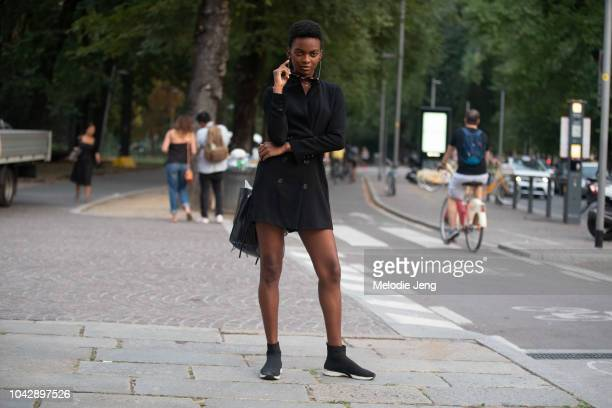 Model Aube Jolicoeur wears all black sunglasses jacket and sock sneakers after Agnona during Milan Fashion Week Spring/Summer 2019 on September 22...