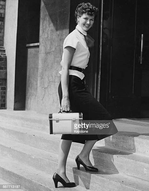 Model Audrey White pictured arriving at an audition for a television announcer at Alexandra Palace London September 1st 1951
