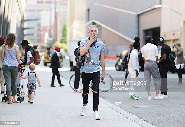 Model August Gonet is seen outside the Capsule show wearing Levi's jeans vintage shirt and Nike sneakers during New York Fashion Week Men's S/S 2016...