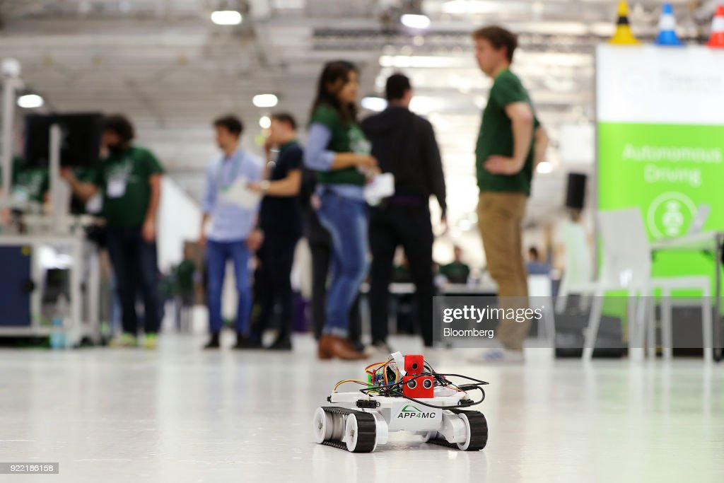 A model autonomous vehicle drives across the floor at the Bosch Internet of Things (IoT) conference, in Berlin, Germany, on Wednesday, Feb. 21, 2018. Bosch raked in record profit and revenue last year and foresees more growth in 2018 even as the German auto-parts giant wrestles with weakness in the scandal-beset diesel segment that might be compounded by controversial air-quality tests on monkeys. Photographer: Krisztian Bocsi/Bloomberg via Getty Images