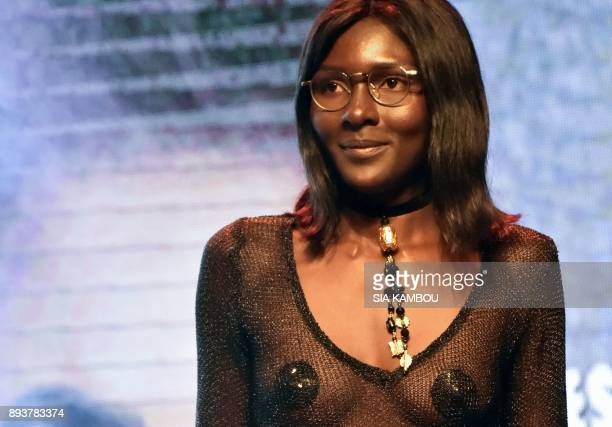 Model Awa Sanoko reacts on stage after received an award during the 8th African Model Exhibition Awards on December 15 in Abidjan / AFP PHOTO / SIA...